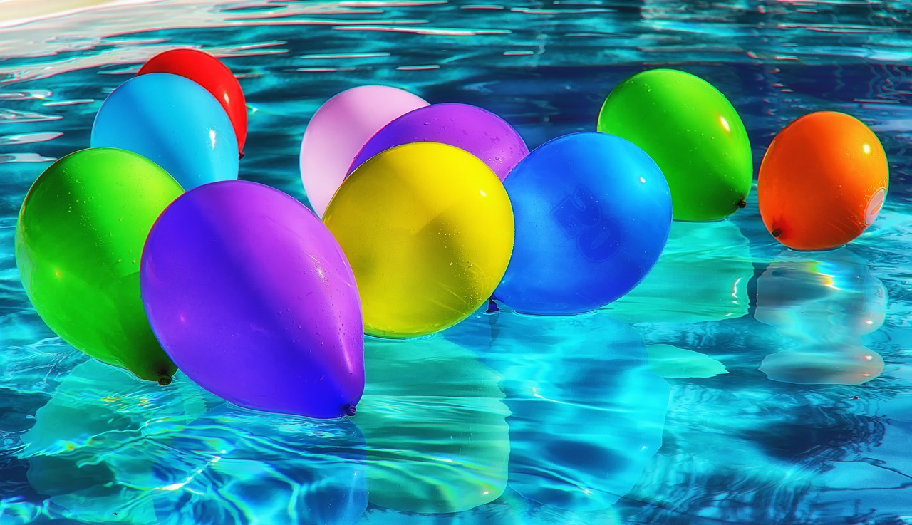 Balloons on the pool for pool party.