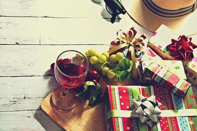 Valentine's idea: Gift boxes, fruits, and wine glass on a table
