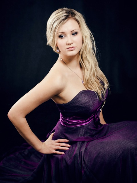 Girl wearing a violet dress for prom night.