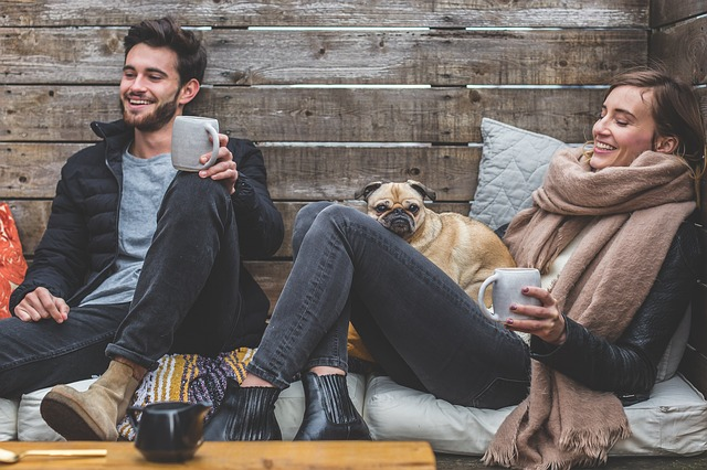 Man and woman smiling in a stress-free way.