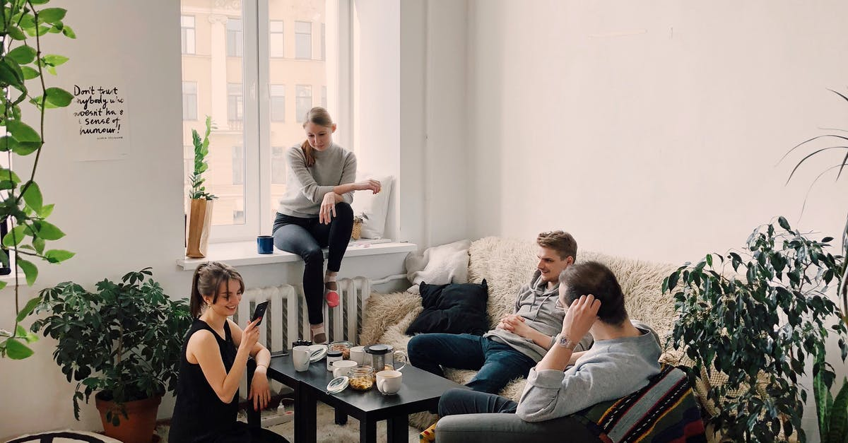 A group of people sitting around a living room