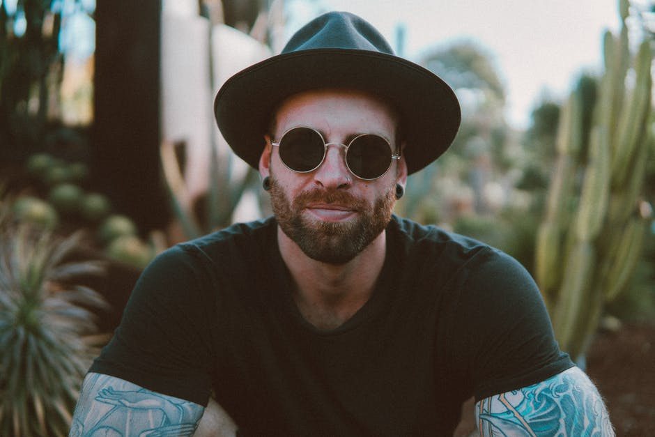 A man wearing sunglasses and a hat